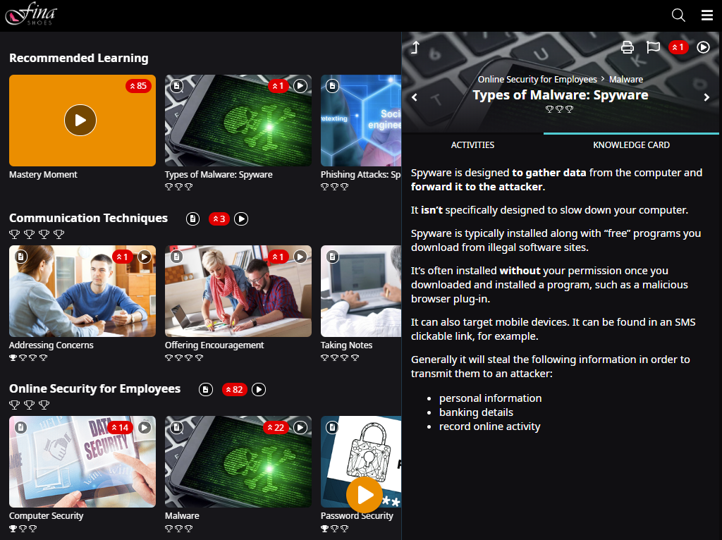 Image showing the learner interface. The Knowledge Card icon appears on several Topic content tiles. A Knowledge Card called for the Types of Malware: Spyware Concept is open in the context panel.
