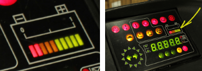 Two images. The image on the left shows a close up of the charge indicator. The image on the right shows the charge indicator on the right side of the forklift dashboard, below the row of warning buttons at the top of the dashboard.