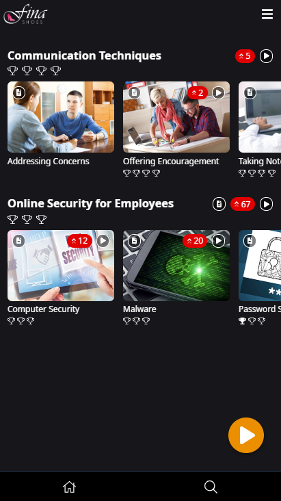 Image showing the learner interface. The Knowledge Card icon appears on several Topic content tiles and beside the Online Security for Employees Module title.